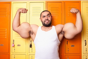 Okay, guys. I get it. Size matters to you. But, really? Worlds largest biceps. I bet you also have the record for limited wardrobe.